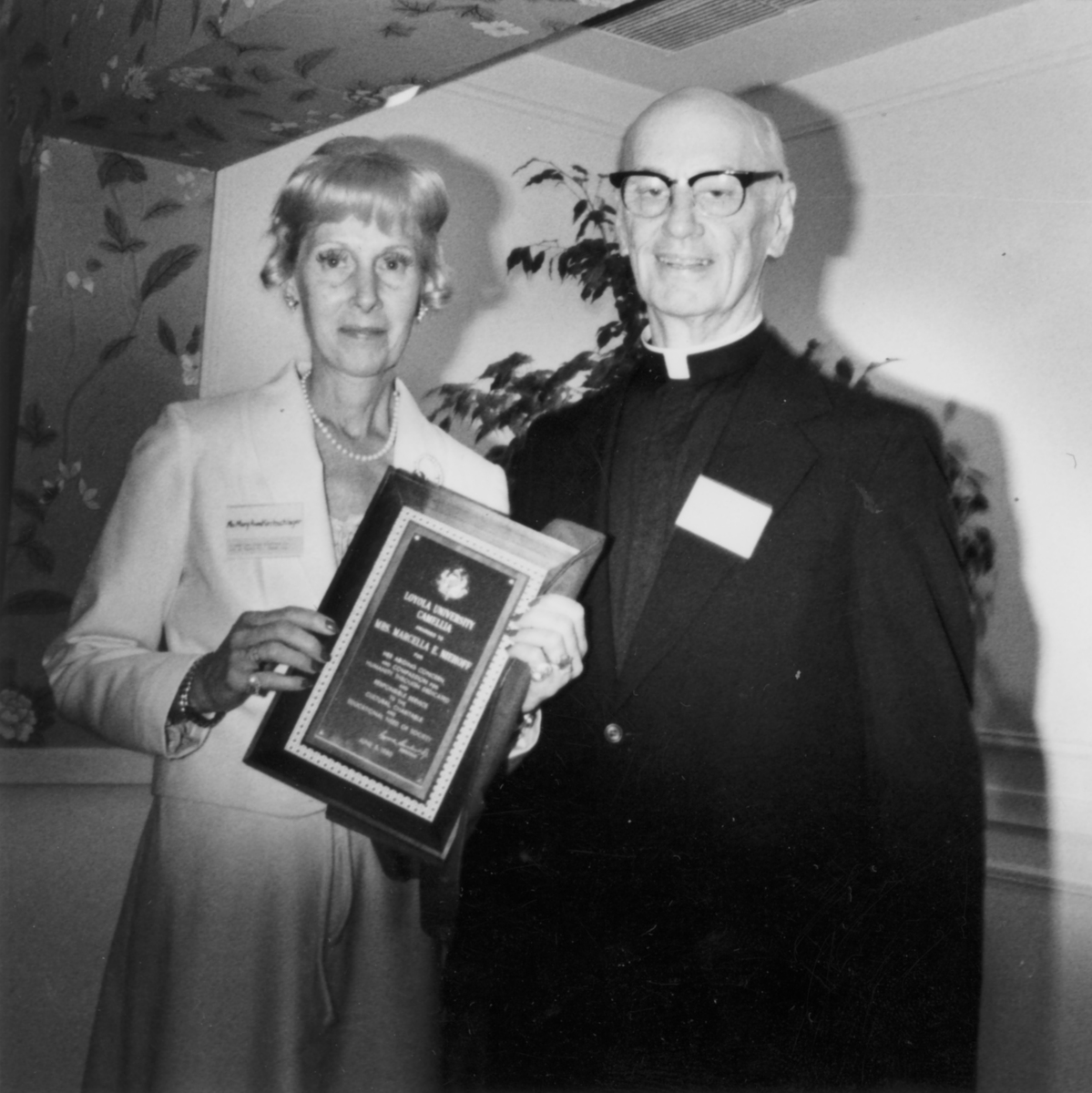 Mary Anne Kirchschlager, daughter of Marcella Niehoff, receiving the Camellia Award for Mrs. Marcella Neihoff