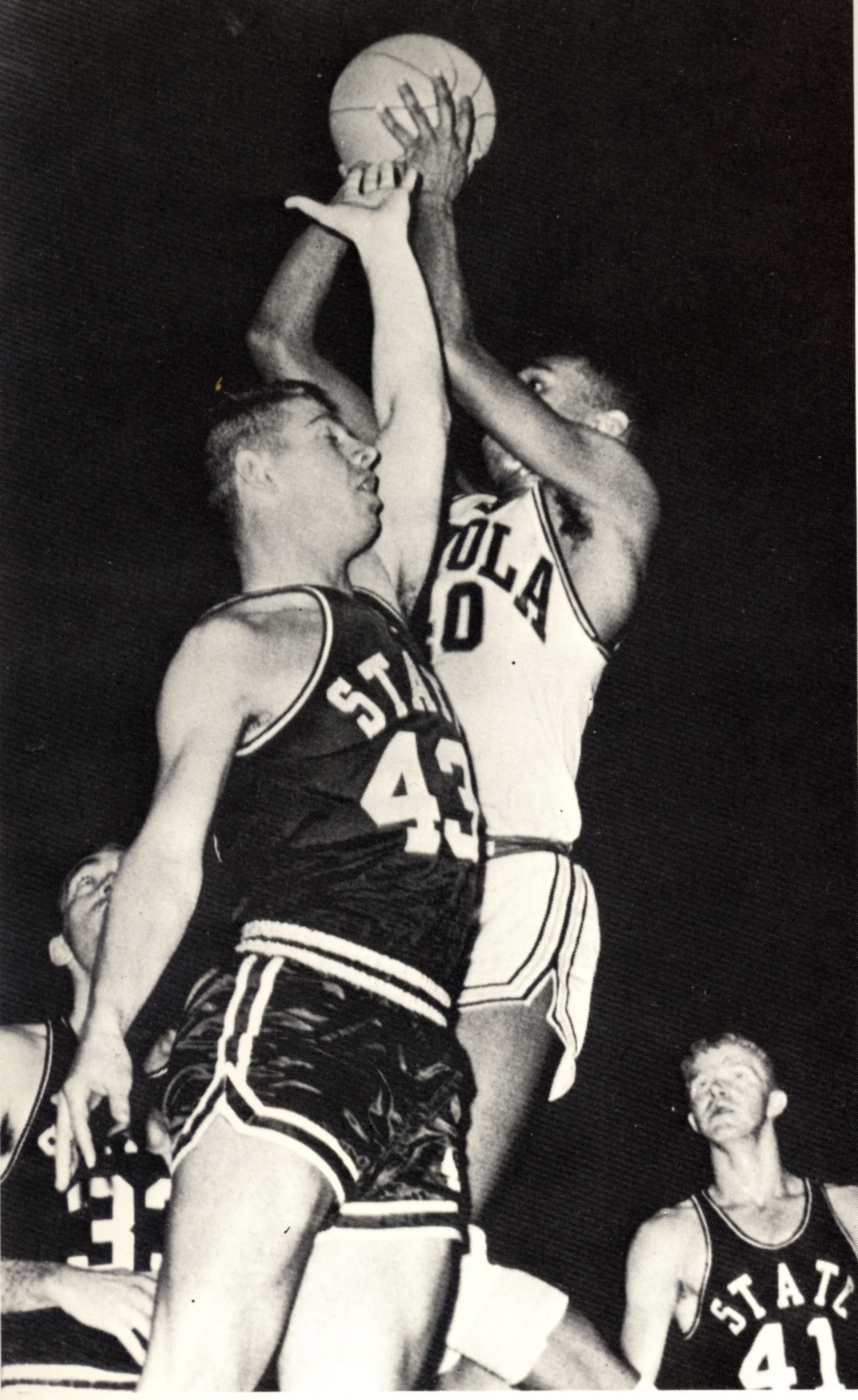 Loyola player Vic Rouse soars high for a basket against Mississippi State in the NCAA Regional Semi-finals. Image from the1963 Loyolan.