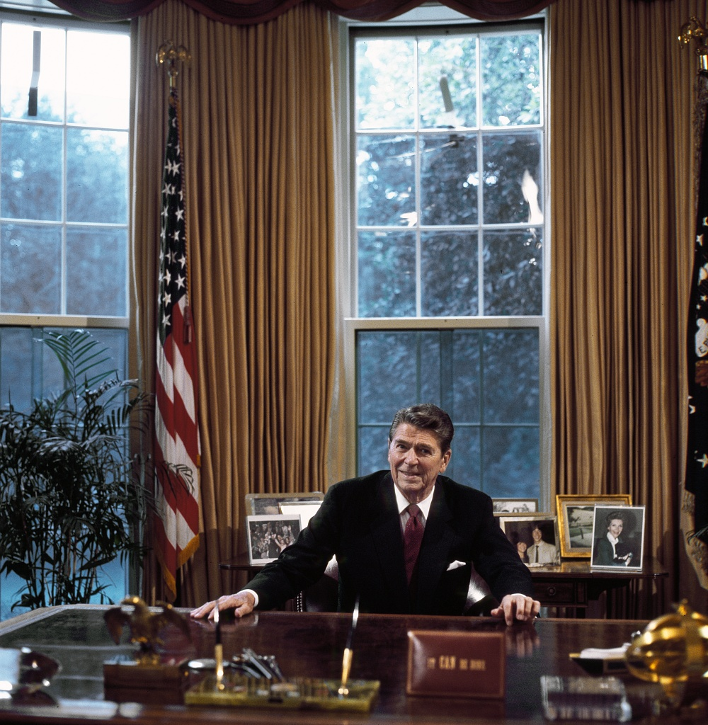 President Ronald Reagan At His Desk In The Oval Office Washington D C