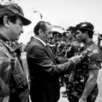 Presidente José Napoleón Duarte and General Blandon with Salvadoran soldiers.
