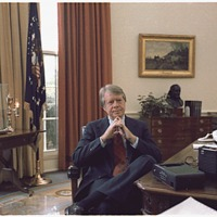 Jimmy Carter at his desk in the Oval Office, 12/13/1977