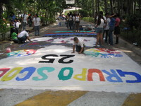 Artists create a street mural to commemorate the Salvadoran Martyrs, 2006.